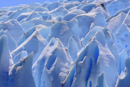 serac: The Tops of Blue Ice on the Grey Glacier in the Patagonian Andes in Chile
