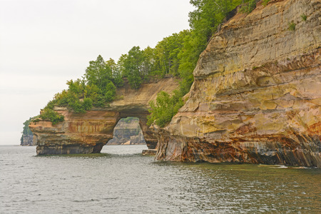 lakeshore: Colorful Sea Arch in Pictured Rocks National Lakeshore in Michigan