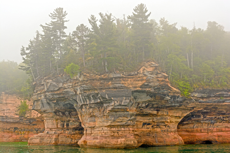 lakeshore: Flower Pot Rocks in the Fog on the shore of Lake Superior in  Pictured Rocks National Lakeshore