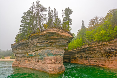 a battleship: Battleship Row in Pictured Rocks National Lakeshore on Lake Superior in Northern Michigan Stock Photo