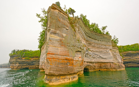 lakeshore: Jagged Rock on a Colorful Lakeshore at Pictured Rocks National Lakeshore on Lake Superior in Northern Michigan