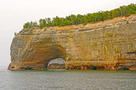 pictured: Sea Arch in a Sandstone Cliff in Pictured Rocks National Lakeshore on Lake Superior, in Northern Michigan Stock Photo