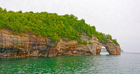 lakeshore: Sea Arch on Colorful Cliffs in Pictured Rocks National Lakeshore in Michigan Stock Photo