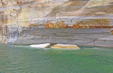 lakeshore: Sandstone Icebergs in the Water in Pictured Rocks National Lakeshore in Michigan Stock Photo