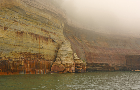 lakeshore: Colorful Cliffs in the Fog in Pictured Rocks National Lakeshore in Michigan Stock Photo