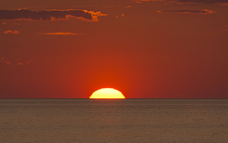 hatteras: Sun Setting into the Ocean over Pamlico Sound near Buxton, Carolina on the Outer Banks