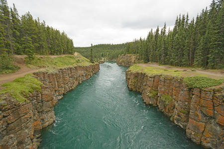 Fast Moving Water in a Miles Canyon in the Yukon Stock Photo