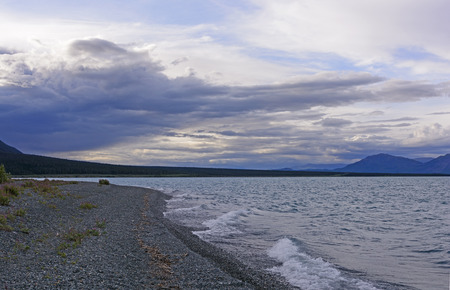 yukon territory: Clouds and Waves in the Twilight on Kluane Lake in the Yukon Territory of Alaska Stock Photo