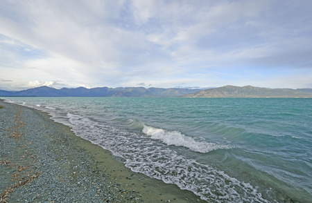 yukon territory: Colorful Water and Mountains in the Wilds on Kluane Lake in the Yukon Territory