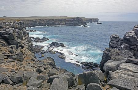 galapagos: Rocky Volcanic Island Coast on Espanola Island in the Galapagos Stock Photo