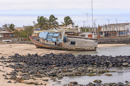 aground: Old Ship Aground on a Beach on San Cristobal Island in the Galapagos