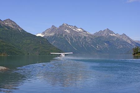 Float Plane Taking off From Crescent Lake in Lake Clark National Park in Alaska