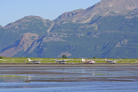 hallo: Airplanes Lined up on a Remote Shore on Hallo Bay in Katmai National Park in Alaska