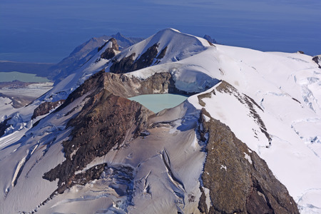 active volcano: Caldera Lake in an Active Volcano on Mount Douglas in the Alaska Peninsula of Alaska Stock Photo