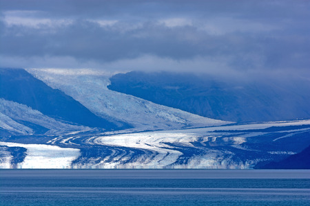william: Harvard Glacier Coming Out of the Clouds in Prince William Sound Stock Photo