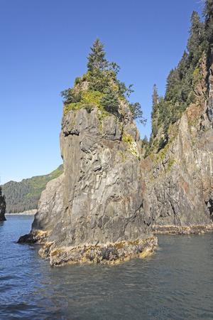 alaska scenic: Sea Stack in Porcupine Bay in Kenai Fjords National Park In Alaska Stock Photo