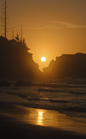 oregon coast: Setting Sun Through Coastal Rocks on the Oregon Coast