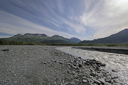 alluvial: High Clouds over an Alluvial Bed near the Exit Glacier in Chugach National Forest in Alaska Stock Photo
