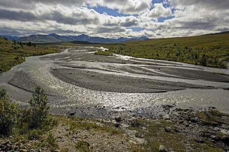 alaska scenic: Sun and Clouds on the braided Savage River in Denali National Park in Alaska