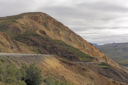 polychrome: Dirt Road Through Rugged Polychrome Pass in Denali National Park in Alaska Stock Photo