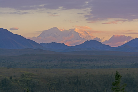 denali: Distant Sunset of Denali in Denali Park from Savage River in Alaska Stock Photo