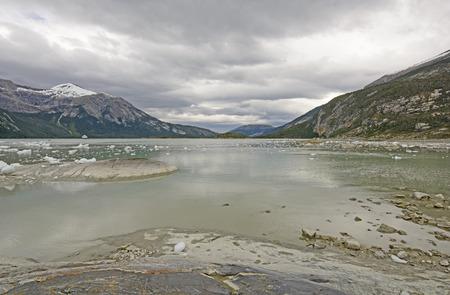 glacial: Clouds over a Colorful Glacial Bay by the Pia Glacier in Tierra del Fuego in Chile