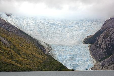 fuego: The Italian Glacier coming out of the Clouds in Glacier Alley of Tierra del Fuego