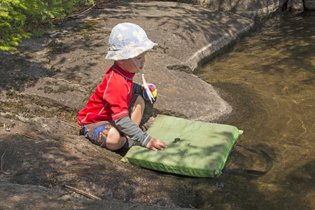 waters: Little Boy Playing on the Lakeshore in the Boundary Waters of Minnesota