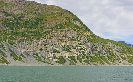 barren: Barren Cliffs of a Glacial Fjord of the Columbia Glacier Stock Photo