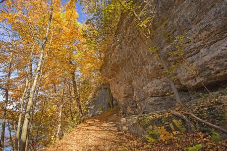 the backbone: Hiking a Cliff Trail in the Fall in Backbone State Park in Iowa Stock Photo