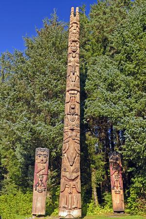 sitka: Totem Poles at a Coastal Preserve in Sitka National Historic Park in Alaska Stock Photo