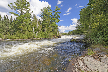 Rushing falls in the North Woods of the Falls Chain in Quetico Provincial Park in Ontario Stock Photo