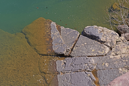 Colorful Rocks and Water in the Sun in Johnsons Shut-ins State Park in Missouri Stock Photo
