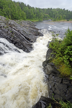 Dramatic Natural Chute in a Wild River in Chutes Provincial Park in Ontario, Canada Stock Photo