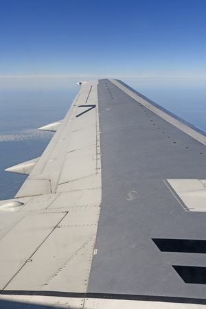 Jet Airplane Wing in Flight over the Arctic in Northern Canada Stock Photo
