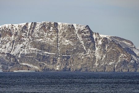 Dramatic Cliffs with Early Fall Snow on Baffin Island in Nunavut, Canada Imagens