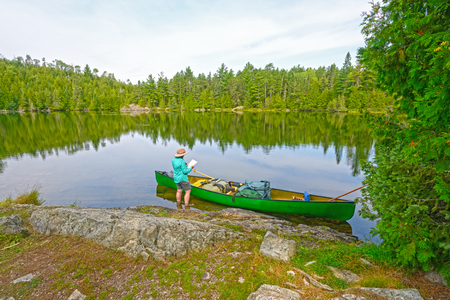 Plotting Your Course into the Wilderness on Ottertrack Lake in the Boundary Waters in Minnesota Stock Photo