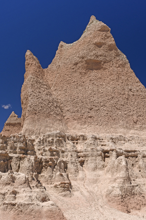 Dramatic Badlands Pinnacle against a Blue Sky in Badlands National Park in South Dakota