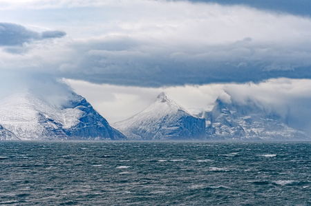 Storm Clouds and Peaks in Sam Ford Fjord, Baffin Island in Nunavut, Canada Stock Photo