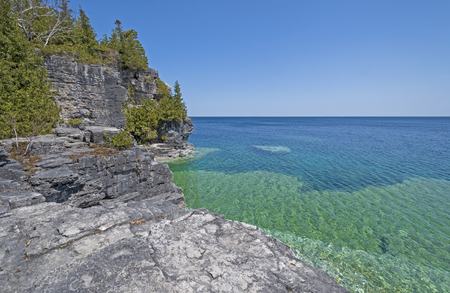 Colorful Cliffs above and Below the Water on Lake Huron in Bruce Peninsula National Park in Ontario, Canada