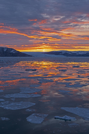 Colorful Reflections in a Calm Arctic Ocean near Eqip Sermia Glacier on the West Coast of Greenland