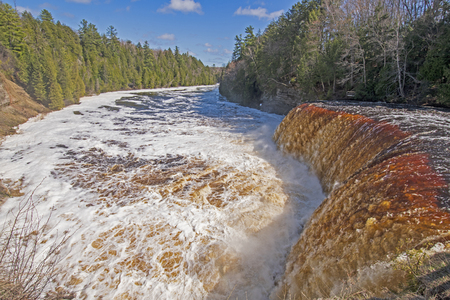 Rushing Waters over a Flooded Upper Tahquamenon Falls in Tahquamenon Falls State Park in Upper Michigan