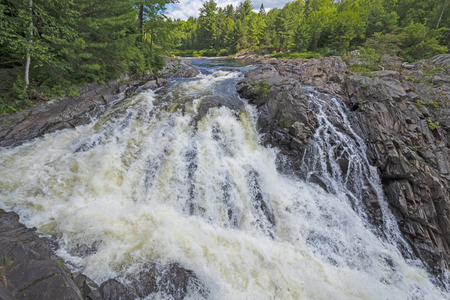 Roaring Falls over a Rocky Outcrop in Chutes Provincial Park near Massey, Ontario