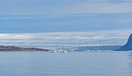 The Greenland Icefield Viewed from the Coast near Eqip Sermia in a Greenland Fjord