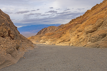 Colorful Rocks around a Desert Wash in Mosaic Canyon in Death Valley National Park in California Imagens