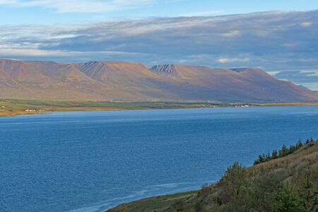 Tablelands above a Colorful Fjordin the Eyjafjord near Akureyri 免版税图像