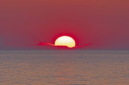 The Sun Setting into a PIllow Of Clouds on the Shores of Lake Michigan near Montague, Michigan