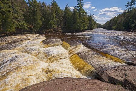 Flat Rock Cascade in the Spring Flood on the Presque Isle River in Porcupine Mountains State Park in Michigan