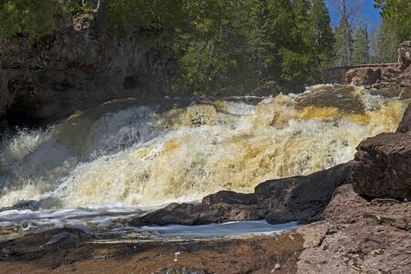 Roiling Waters Rushing Through a Canyon on the Fifth Falls at Gooseberry Falls State Park in Minnesota