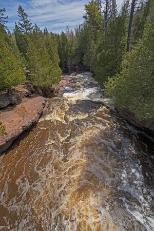Spring Waters Rushing Down a Narrow Canyon on the Gooseberry River in Gooseberry Falls State Park in Minnesota